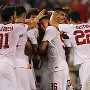 Marco Borriello, AS Roma, is mobbed by teammates after his injury time winning goal from a corner during the Liverpool Vs AS Roma friendly pre season football match at Fenway Park, Boston. USA. 23rd July 2014. Photo Tim Clayton