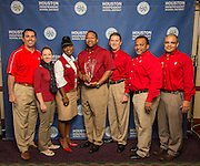 Target team members pose with a Hall of Fame trophy following the Houston ISD Partnership Appreciation breakfast at Kingdom Builders, October 25, 2013.
