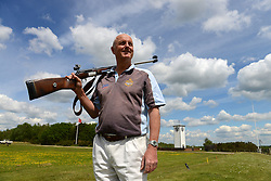 © Licensed to London News Pictures. 14/05/2014. London. Bisley shooting range. David Calvert who lives in Cambridge will be representing N. Ireland at his 10th Commonwealth Games in Glasgow this Summer. This makes him the sportsman to compete at most CG ever. His 1st games was Edmonton 1978. He shoots .308 Full Bore Rifle and already has 4 gold medals & 4 bronze medals.. Photo credit : Mike King/LNP