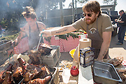 Irish Chef J P McMahon, right, and Brandon Baltzley prepare BBQ pig during Cook it Raw outdoor BBQ event on Bowen's Island October 26, 2013 in Charleston, SC.
