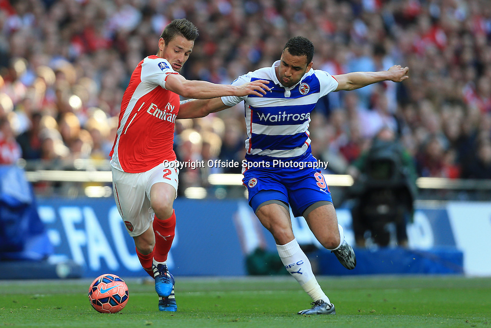 18th April 2015 - FA Cup - Semi-Final - Reading v Arsenal - Mathieu Debuchy of Arsenal battles with Hal Robson-Kanu of Reading - Photo: Simon Stacpoole / Offside.