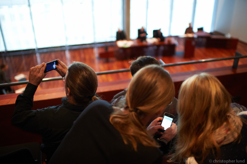 Members of the german Piraten Partei  whatching a meeting in the Reykjavik City Hall.