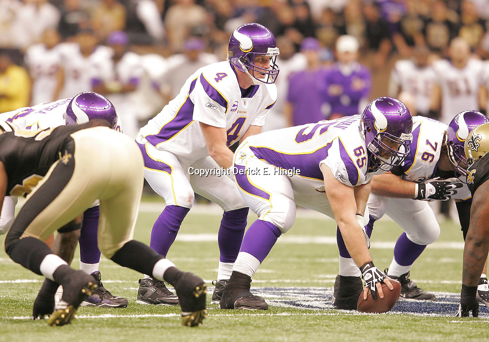 Jan 24, 2010; New Orleans, LA, USA; Minnesota Vikings quarterback Brett Favre (4) under center during a 31-28 overtime victory by the New Orleans Saints over the Minnesota Vikings in the 2010 NFC Championship game at the Louisiana Superdome. Mandatory Credit: Derick E. Hingle-US PRESSWIRE