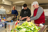 Mitchell Boutwell and Mike Izard do prep work for the dressing at the annual Hazel Duke Thanksgiving Day dinner at the Congregational Church on Wednesday morning.  (Karen Bobotas/for the Laconia Daily Sun)