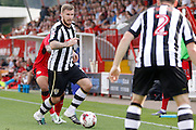 Notts County midfielder Michael O'Connor (8) plays a pass during the EFL Sky Bet League 2 match between Crawley Town and Notts County at the Checkatrade.com Stadium, Crawley, England on 27 August 2016. Photo by Andy Walter.