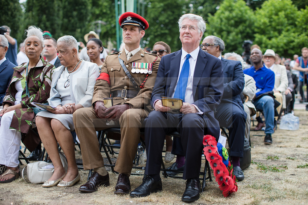 © Licensed to London News Pictures. 22/06/2017. London, UK. Defence Secretary Michael Fallon (R) attends the inauguration of the African Caribbean War Memorial in Windrush Square in Brixton, south London, on Windrush Day. The memorial remembers the many African and Caribbean servicemen that fought in the Second World War. Photo credit: Rob Pinney/LNP