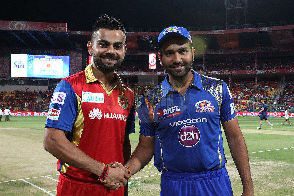 Royal Challengers Bangalore captain Virat Kohli and Mumbai Indians captain Rohit Sharma shake hands after the toss during match 16 of the Pepsi IPL 2015 (Indian Premier League) between The Royal Challengers Bangalore and The Mumbai Indians held at the M. Chinnaswamy Stadium in Bengaluru, India on the 19th April 2015.<br /> <br /> Photo by:  Shaun Roy / SPORTZPICS / IPL