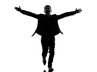 one caucasian business man arms outstretched in silhouette on white background