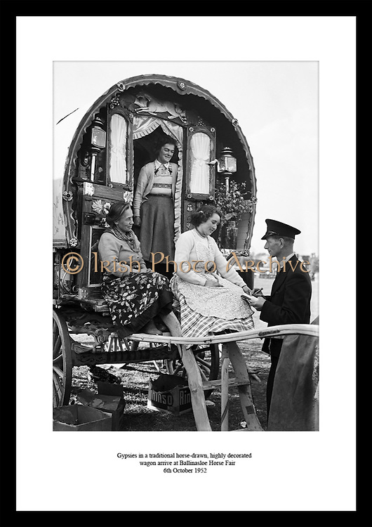 Gypsies in a traditional horse-drawn, highly decorated wagon arrive at Ballinasloe Horse Fair<br /> 6th October 1952