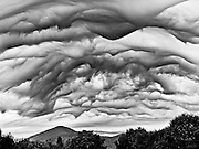 Unusual dark chaotic storm clouds fill the sky over Black Nubble Mountain in Kingfield, Maine