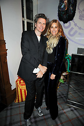JOHN TAYLOR and YASMIN LE BON at the Juicy Couture children's tea party in aid of Mothers 4 Children held at the Juicy Couture Store, Bruton Street, London on2nd December 2009.