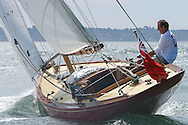 "ENGLAND, Solent. 31st July 2004. West Solent One Design ""Arrow"" W1 helmed by owner Phil Plumtree."