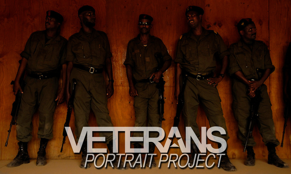 Djiboutian policemen lean on a wall during a short break in training on Nov. 16, 2005.Djiboutian police train in counter terrorism measures with the US Marine Corps off the Horn of Africa.