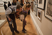 FREDDIE JOHANSSON; HANNAH BELLAMY LOOKING AT IDRIS KHAN PHOTO, No New Thing Under the Sun. Royal Academy. Piccadilly. London. 20 OCTOBER 2010. -DO NOT ARCHIVE-© Copyright Photograph by Dafydd Jones. 248 Clapham Rd. London SW9 0PZ. Tel 0207 820 0771. www.dafjones.com.