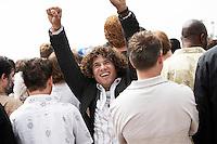 Man Raising His Fists at Rally