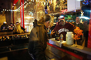 Brian Campbell of Fort Worth buys beer before the pre-Cotton Bowl midnight Aggie Yell practice at Stockyards Station in Fort Worth, Texas, on January 4, 2012.  (Stan Olszewski/The Dallas Morning News)