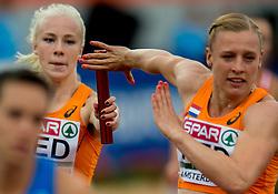 09-07-2016 NED: European Athletics Championships day 4, Amsterdam<br /> Stokje doorgeven, wissel, estafette, timing, item atletiek, samen