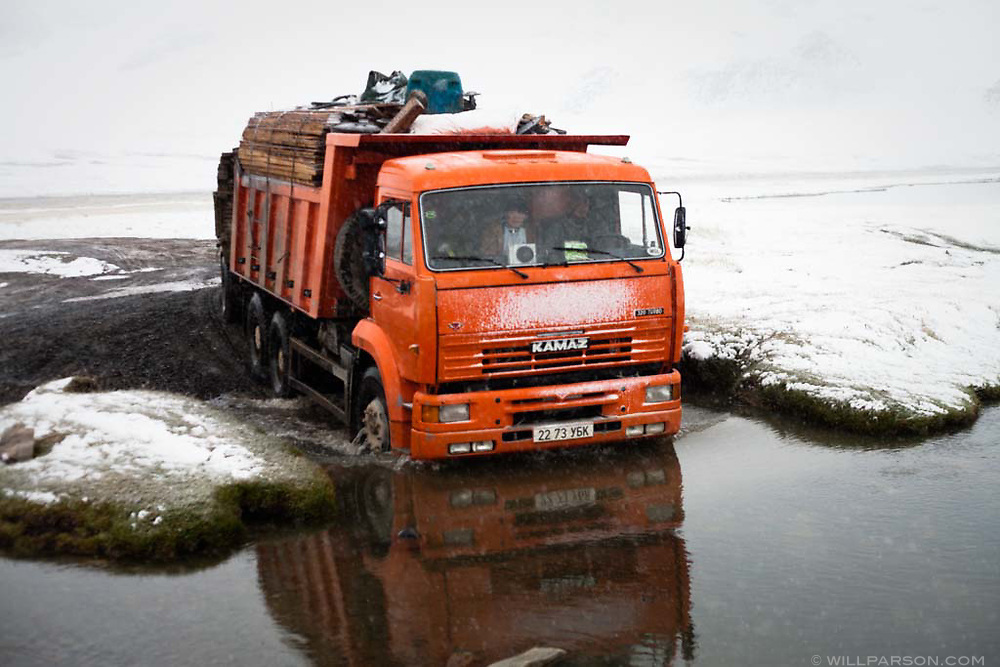 A truck carries a family's disassembled ger, among other things, in western Mongolia's Bayan-Ölgii Province.