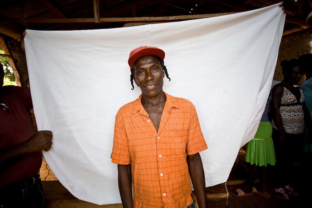 A Chemen Lavi Miyò  client poses for a picture. La Gonave, Haiti. Photo by Ben Depp. 10/23/2008.