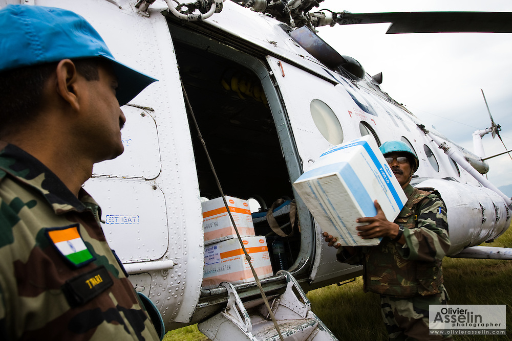 UN peacekeepers unload cargo from a helicopter in Kanyabayonga, Eastern Democratic Republic of Congo, during a visit on Thursday December 11, 2008..