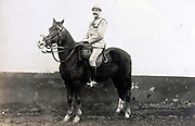 soldier on horse posing with a wall as background France 1910s