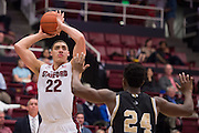 November 14, 2014; Stanford, CA, USA; Stanford Cardinal forward Reid Travis (22) shoots the basketball against Wofford Terriers forward Justin Gordon (24) during the first half at Maples Pavilion.