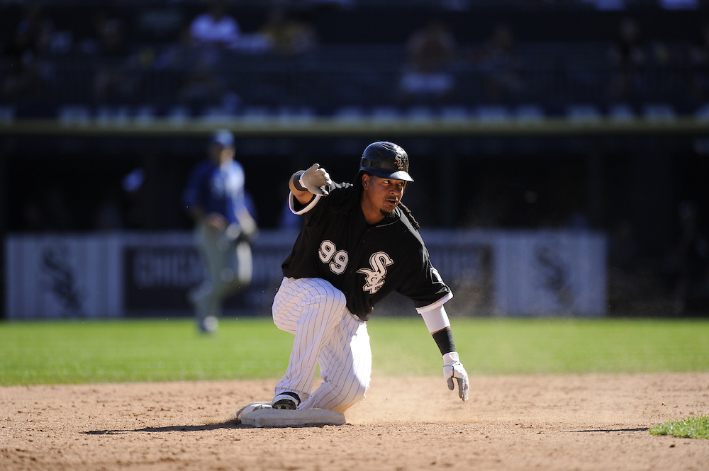 CHICAGO - SEPTEMBER 12:  Manny Ramirez #99 of the Chicago White Sox slides into second base against the Kansas City Royals on September 12, 2010 at U.S. Cellular Field in Chicago, Illinois.  The White Sox defeated the Royals 12-6.  (Photo by Ron Vesely)
