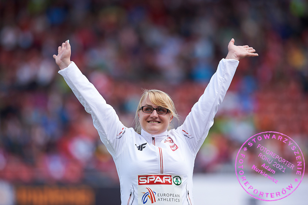 Joanna Fiodorow from Poland celebrates her bronze medal in women's hammer throw while medal ceremony during the Fifth Day of the European Athletics Championships Zurich 2014 at Letzigrund Stadium in Zurich, Switzerland.<br /> <br /> Switzerland, Zurich, August 16, 2014<br /> <br /> Picture also available in RAW (NEF) or TIFF format on special request.<br /> <br /> For editorial use only. Any commercial or promotional use requires permission.<br /> <br /> Photo by &copy; Adam Nurkiewicz / Mediasport