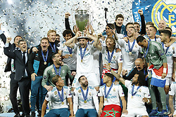 (L-R) goalkeeper Kiko Casilla of Real Madrid, Marcos Llorente of Real Madrid, Jesus Vallejo of Real Madrid, Nacho of Real Madrid with UEFA Champions League trophy, Coupe des clubs Champions Europeens, Daniel Carvajal of Real Madrid, Raphael Varane of Real Madrid, Luka Modric of Real Madrid, Achraf Hakimi of Real Madrid, Sergio Ramos of Real Madrid, Marcelo of Real Madrid, goalkeeper Keylor Navas of Real Madrid, Lucas Vazquez of Real Madrid, Marco Asensio of Real Madrid during the UEFA Champions League final between Real Madrid and Liverpool on May 26, 2018 at NSC Olimpiyskiy Stadium in Kyiv, Ukraine