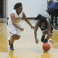 Trask's Saniyyah Mccallister, right, and Topsail's Davisha Sidburry scramble for a loose ball Friday December 5, 2014 at Topsail High School in Hampstead, N.C. (Jason A. Frizzelle)