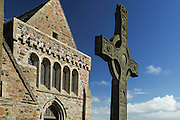 Hebrides, Iona island. The Abbey. In the foreground the St John High Cross.