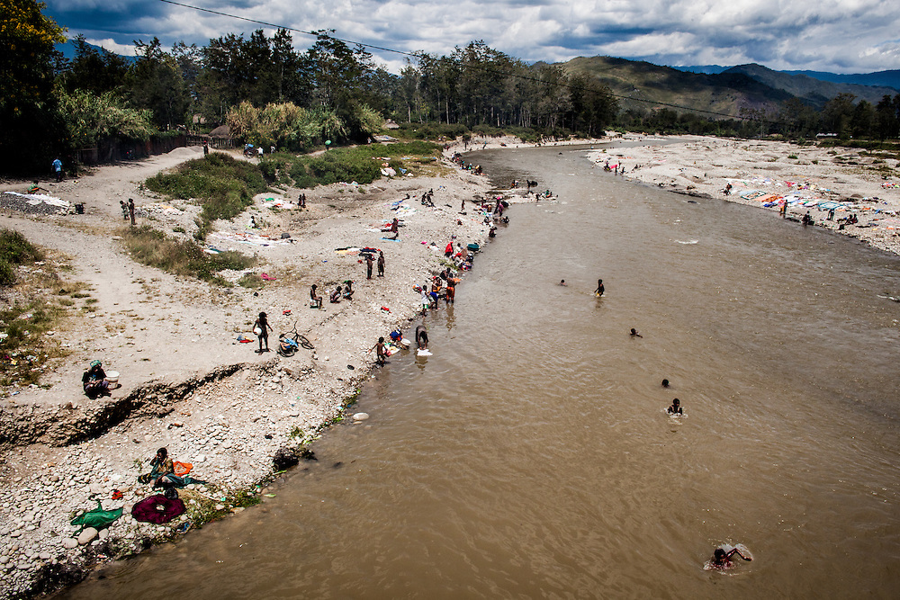 People are seen bathing and washing clothes are Wouma River in Wamena, Jayawijaya district, a mountainous region in Papua.<br /> <br /> It is estimated that at least 3% of 2.5 million inhabitants in Papua is already infected with HIV/AIDS.  However, the prevalence rate for HIV among indigenous Papuans is estimated at 7% and they account for 75% of the total number of recorded infection.  Currently, Wamena has 1,894 recorded HIV/AIDS cases and the number continues to rise.  HIV/AIDS is spreading at an alarming rate impacting the general population including children, men and women, husbands and wives, young and old, families and communities.