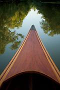The bow of a handmade canoe as it is paddled on the Olentangy River in Central Ohio.