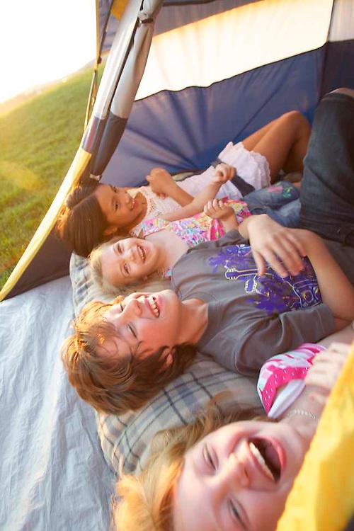 Sears National Advertising of kids enjoying s backyard camping trip at sunset on huge lawn