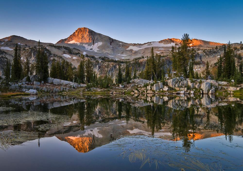 Eagle Cap mountain and  Sunshine Lake at sunrise; Lakes Basin, Eagle Cap Wilderness, Wallowa Mountains, northeastern Oregon.