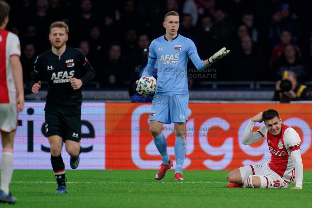 Marco Bizot #1 of AZ Alkmaar, Dusan Tadic #10 of Ajax in action during the Dutch Eredivisie match round 25 between Ajax Amsterdam and AZ Alkmaar at the Johan Cruijff Arena on March 01, 2020 in Amsterdam, Netherlands