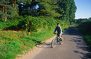 A089H1 Child cycling on small Suffolk road