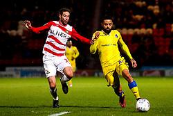 Alex Jakubiak of Bristol Rovers takes on Matty Blair of Doncaster Rovers - Mandatory by-line: Robbie Stephenson/JMP - 26/03/2019 - FOOTBALL - Keepmoat Stadium - Doncaster, England - Doncaster Rovers v Bristol Rovers - Sky Bet League One