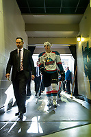 KELOWNA, CANADA - MARCH 24: Kelowna Rockets' head coach, Jason Smith and Cal Foote #25 of the Kelowna Rockets head to the dressing room after second period against the Kamloops Blazers on March 24, 2017 at Prospera Place in Kelowna, British Columbia, Canada.  (Photo by Marissa Baecker/Shoot the Breeze)  *** Local Caption ***