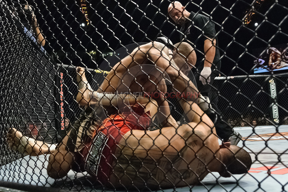 """NEWCASTLE, ENGLAND, UNITED KINGDOM, JANUARY 19 2008: Jorge Rivera (top) lands a punch to the head of Kendall Grove during """"UFC 80: Rapid Fire"""" inside the Metro Radio Arena in Newcastle, England on January 19, 2008."""