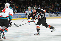 KELOWNA, CANADA, FEBRUARY 17: Brooks Macek #11 of the Calgary HItmen takes a shot at the Kelowna Rockets on February 17, 2012 at Prospera Place in Kelowna, British Columbia, Canada (Photo by Marissa Baecker/Shoot the Breeze) *** Local Caption ***
