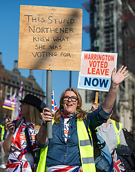 © Licensed to London News Pictures. 29/03/2019. London, UK. Brexit supporters gather in Parliament Square for a Leave Means Leave rally on 29 March 2019, the day on which the UK was expected to leave the EU. MPs have voted to reject Prime Minister Theresa May's withdrawal agreement for a third time. Photo credit: Rob Pinney/LNP