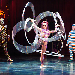London, UK - 4 January 2012: hoops manipulation act during the Cirque Du Soleil Kooza dress rehearsal at the Royal Albert Hall. Since its premiere in April of ..2007, KOOZA has captivated close to four million spectators in North America and Japan.  London will be the first destination of the KOOZA European tour starting the ..5th of January. Written and directed by David Shiner, KOOZA is a return to the origins of Cirque du Soleil combining two circus traditions - acrobatic performance and ..the art of clowning.  KOOZA highlights the physical demands of human performance in all its splendor and fragility, presented in a colorful m&eacute;lange that emphasizes ..bold slapstick humor. This image can be quickly and easily purchased from some of the major international stock agencies:<br />