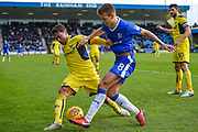 Gillingham FC midfielder Jake Hessenthaler (8) and Oxford United defender Alex Mowatt (27) during the EFL Sky Bet League 1 match between Gillingham and Oxford United at the MEMS Priestfield Stadium, Gillingham, England on 26 December 2017. Photo by Martin Cole.