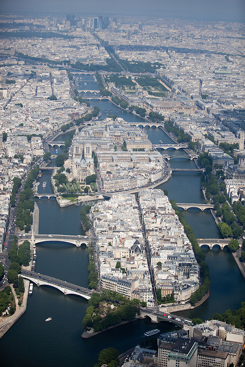 Looking down the Left and Right Banks of the Seine with Ile Saint-Louis and Ile de la Cité, and Notre Dame and numerous bridges linked to the city.