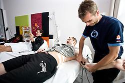 Goran Dragic and Uros Slokar of Slovenia at physiotherapist Gasper Suhadolnik in a Andel's Hotel during Eurobasket 2009, on September 15, 2009 in  Lodz, Poland.  (Photo by Vid Ponikvar / Sportida)