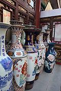 China, Beijing, Busy pedestrian street market Ming dynasty style urns