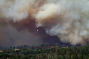 A firefighting airplane flies over Pine Mountain Lake as the Rim Fire encroaches the Groveland, California, gated community on Thursday, August 22, 2013.