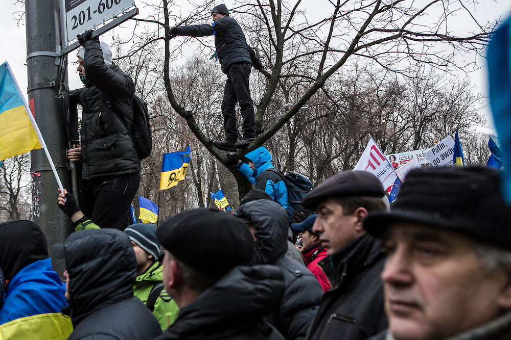KIEV, UKRAINE - DECEMBER 8: Anti-government protesters crowd near a street that leads to the Ukrainian parliament building, the site of a rally held by the ruling Party of Regions in support of the government and Ukrainian president Viktor Yanukovych, on December 8, 2013 in Kiev, Ukraine. Thousands of people have been protesting against the government since a decision by President Yanukovych to suspend a trade and partnership agreement with the European Union in favor of incentives from Russia. (Photo by Brendan Hoffman/Getty Images) *** Local Caption ***