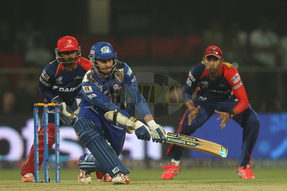 Mitchell McClenaghan of Mumbai Indians is trapped LBW by Imran Tahir of the Delhi Daredevils during match 21 of the Pepsi IPL 2015 (Indian Premier League) between The Delhi Daredevils and The Mumbai Indians held at the Ferozeshah Kotla stadium in Delhi, India on the 23rd April 2015.<br /> <br /> Photo by:  Shaun Roy / SPORTZPICS / IPL